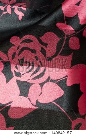 this is a photograph of Fuchsia pink and Black floral print polyester fabric scarf