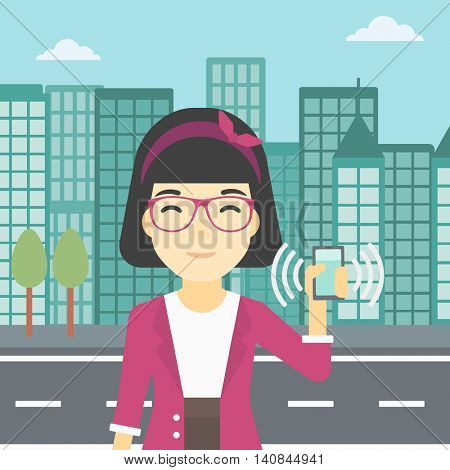 An asian woman holding ringing mobile phone on a city background. Woman answering a phone call. Woman with ringing phone in hand. Vector flat design illustration. Square layout.