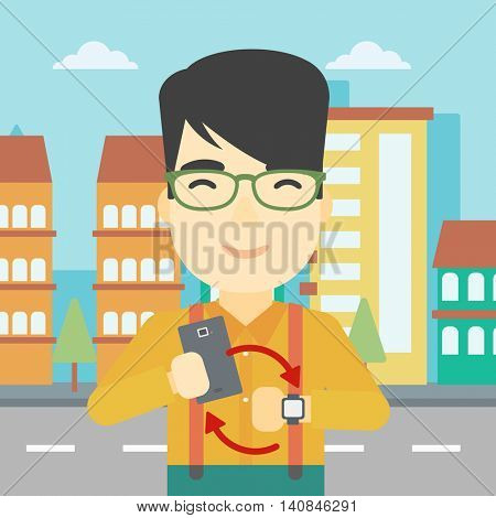An asian young man holding smartphone and looking at his smart watch. Concept of synchronization between smartwatch and smartphone. Vector flat design illustration. Square layout.