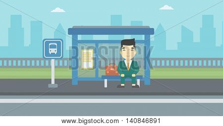 An asian young man waiting for a bus at a bus stop on a city background. Young man sitting at the bus stop. Vector flat design illustration. Horizontal  layout.