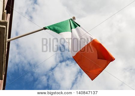 symbolics, patriotism and nationalism concept - close up of irish flag