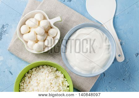 Dairy products on stone table. Sour cream, cheese, yogurt and curd. Top view