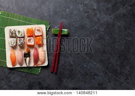 Set of sushi and maki roll on stone table. Top view with copy space