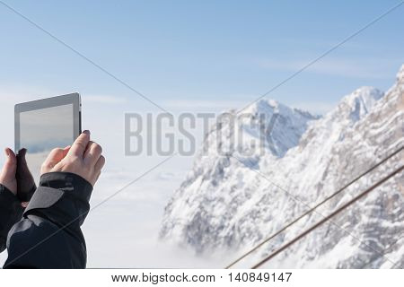 Person photographed with Tablet Dachstein mountains - austria