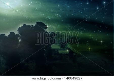 Colorful abstract background of space with nebulae and stars in blue green and dark colors