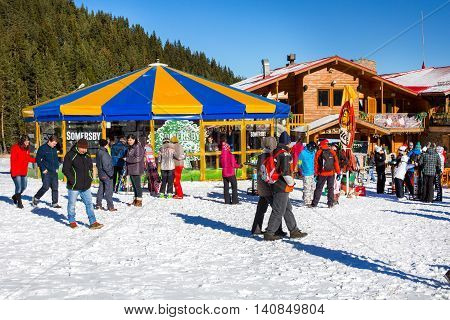 Bansko, Bulgaria - December, 12, 2015: Round cafe at Bunderishka polyana, ski resort Bansko, Bulgaria and people