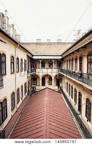 Courtyard of old stylish building in historic centre of Budapest Hungary. Architectural theme. Cultural heritage. Possibility of accommodation. Vertical composition.