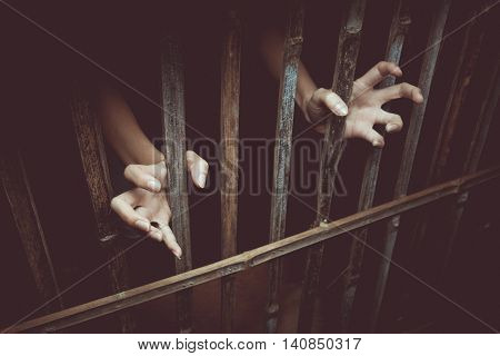 Vintage tone of Female Hands with cage cell. Refugee Concept