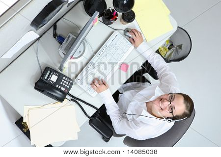 Overhead view of woman at office desk