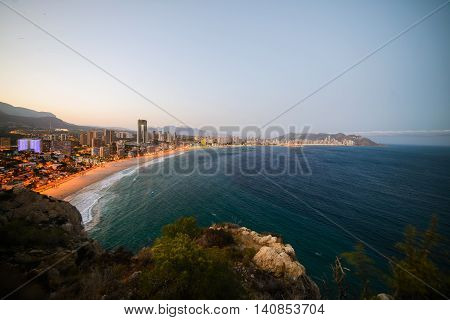 View Of The Coastline In Benidorm At Sunset With City Lights