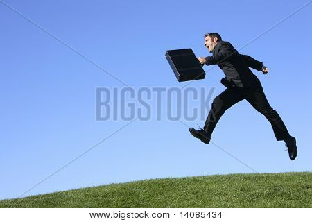 Businessman jumping outdoors
