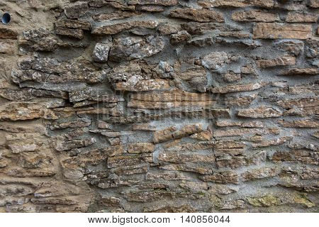 The gray und old stone wall. .