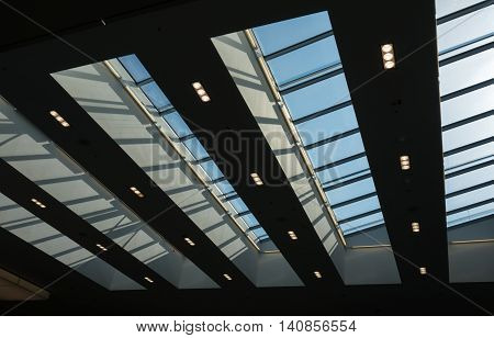 The glass roof of a building against sky