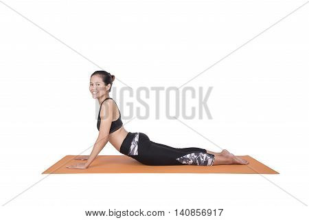 Young woman exercise fitness at yoga class. which is a sport popular for asian women and all over the world.Yoga have useful for healthy lifestyle and body slimming beautiful.