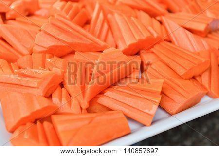 Ripe tasty papaya sliced on white plate