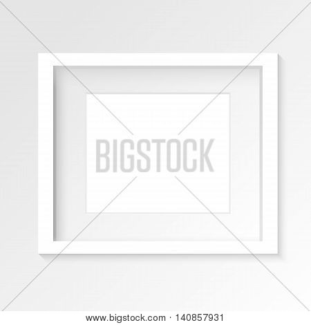 White horizontal photo frame on gray wall with realistic shadows. Vector illustration. EPS10.
