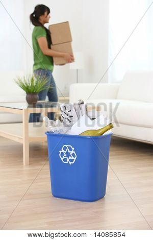 Recycle bin with woman in background