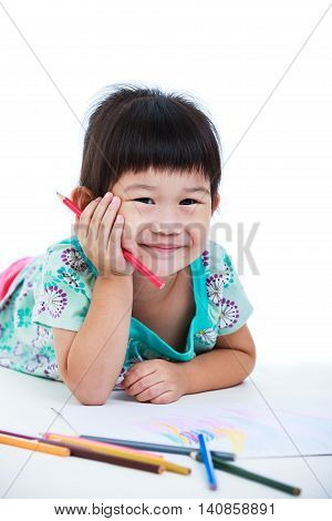 Pretty asian girl lie on the floor looking at camera and smiling. Concepts of creativity and education strengthen the imagination of child. Studio shot. Isolated on white background.