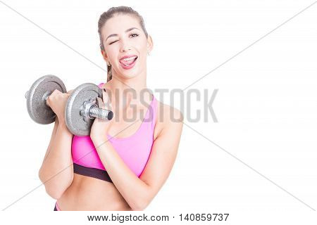 Lady Holding Dumbbell Winking And Making Tongue Gesture