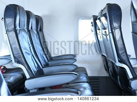 empty seats inside of a airplane. Air travel.