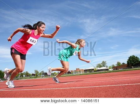 Women running on track