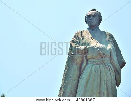 KOCHI, JAPAN - JULY 19, 2016:Statue of Sakamoto Ryoma stands on the hill near Katsurahama beach in Kochi, Japan. Sakamoto Ryoma is a prominent figure in Japan. He was born in Tosa (old name of Kochi).