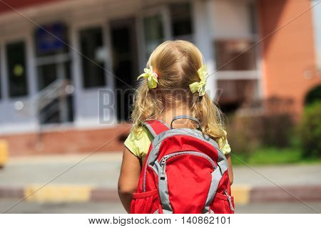 Back to school - little girl with backpack going to school or daycare