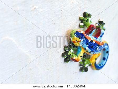 Decorative ceramic gecko or wall lizzard, close-up shot
