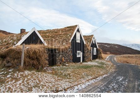 Iceland historical turf houses along a path
