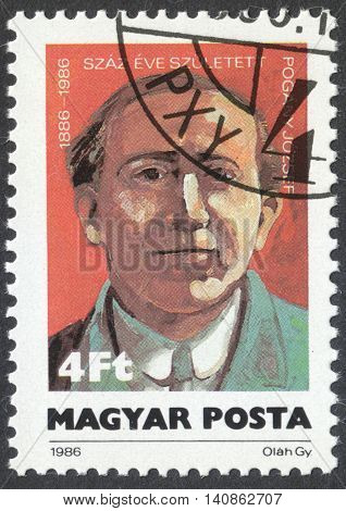 MOSCOW RUSSIA - CIRCA APRIL 2016: a post stamp printed in HUNGARY shows a portrait of Jozseph Pogany devoted to the 100th Anniversary of the Birth of Jozsef Pogany circa 1986