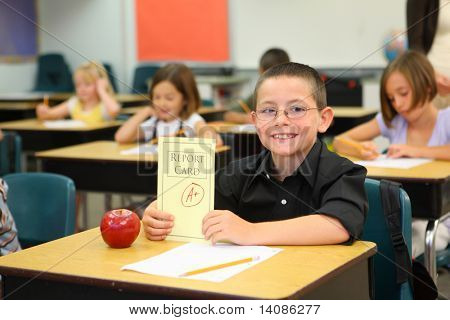 Elementary school student with A+ report card