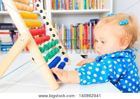 little girl playing with abacus, early learning and daycare