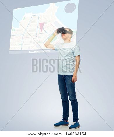 3d technology, virtual reality, entertainment, cyberspace and people concept - happy young man with virtual reality headset or 3d glasses looking at screen with gps navigator map