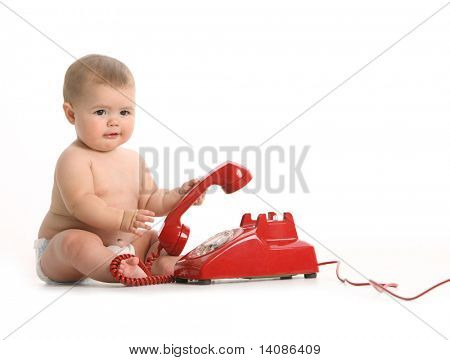 Baby with red phone on white background