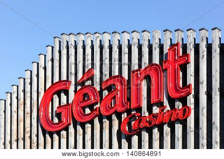 Villefranche sur Saone, France - July 15, 2016: Geant Casino logo on a facade. Geant Casino is a hypermarket chain based in Saint Etienne, France