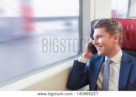 Businessman with phone in a train