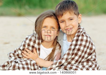 Two cute kids relaxing on beach