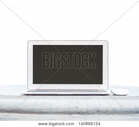 Closeup computer notebook with mouse on cement desk in the park isolated on white background with copy space