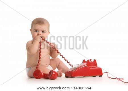 Baby on white background with red telephone