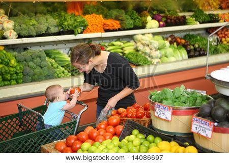 Woman with baby in produce section