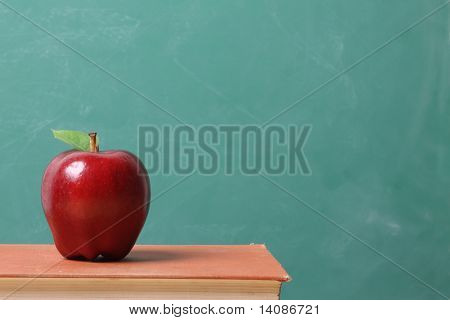 Red apple against a chalkboard background