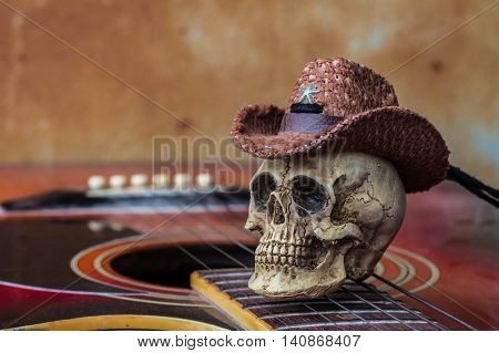 Skull cap on guitar against a background of old.