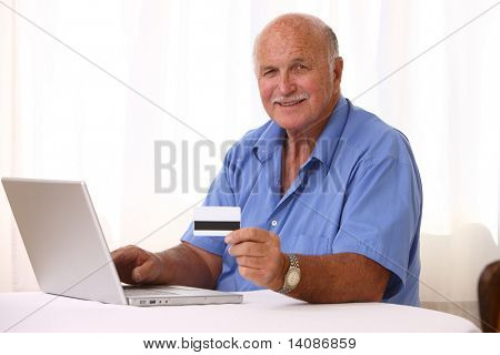 Senior man online shopping
