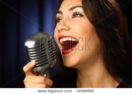 Woman singing with vintage microphone