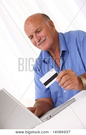 Senior man shopping online