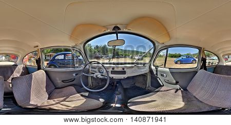 SUB CETATE, ROMANIA - July 16: 360 panorama of the interior of a classic Volkswagen Type 1 Beetle painted grey with fabric seats on July 16th, 2016, in Zeteváralja (Sub Cetate), Transylvania, Romania.