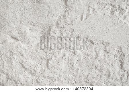 Wall with texture plaster decoration. White textured background, free space, repair mockup