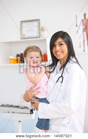 Pediatrician holding young child
