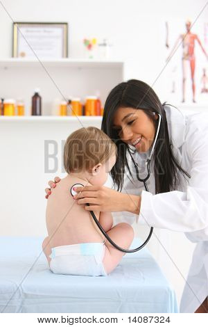 Pediatrician checking baby?s heart beat with stethoscope