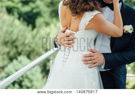 Bride And Groom Embrace Each Other